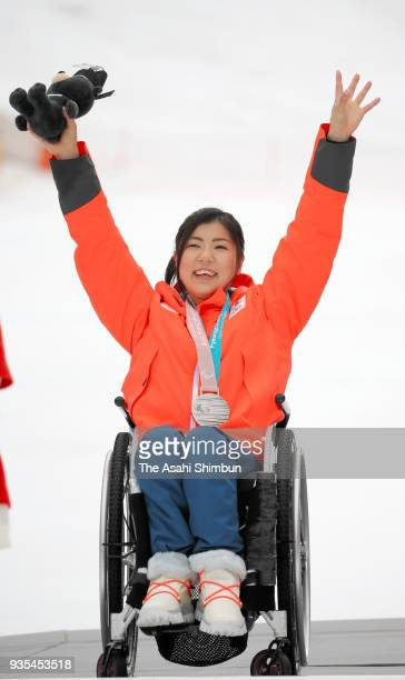 Silver medalist Momoka Muraoka of Japan celebrates on the podium at the medal ceremony for the Alpine Skiing Women's Slalom Sitting during day nine...