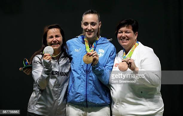 Silver medalist Monica Karsch of Germny gold medalist Anna Korakaki of Greece and Heidi Diethelm Gerber of Switzerland pose on the podium during the...