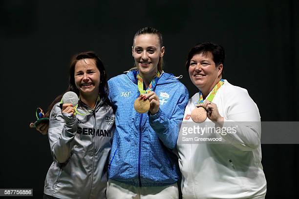 Silver medalist Monica Karsch of Germny gold medalist Anna Korakaki of Greece and Heidi Diethelm Gerber of Switzerland pose on the podium during the...