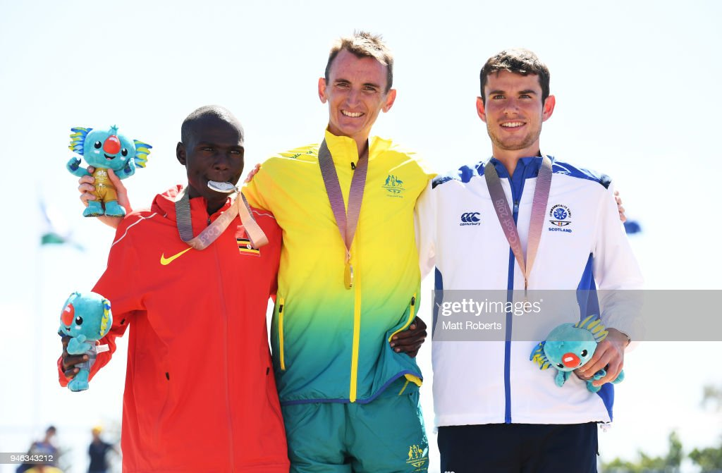 Silver medalist Munyo Solomon Mutai of Uganda, gold medalist Michael Shelley of Australia and bronze medalist Robbie Simpson of Scotland celebrate during the medal ceremony for the Men's marathon on day 11 of the Gold Coast 2018 Commonwealth Games at Southport Broadwater Parklands on April 15, 2018 on the Gold Coast, Australia.