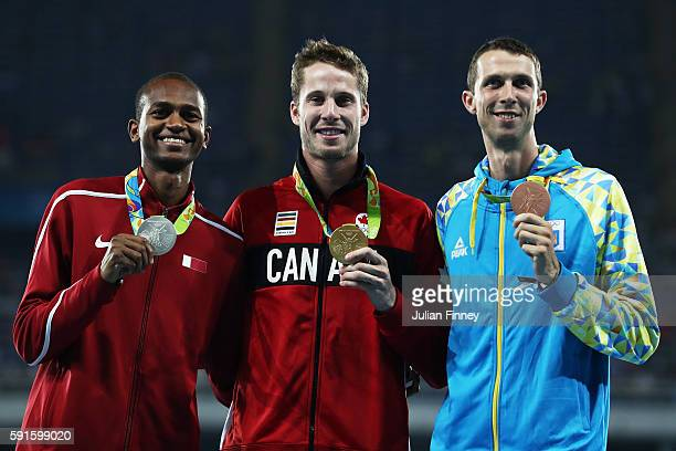 Silver medalist Mutaz Essa Barshim of Qatar gold medalist Derek Drouin of Canada and bronze medalist Bohdan Bondarenko of Ukraine pose on the podium...