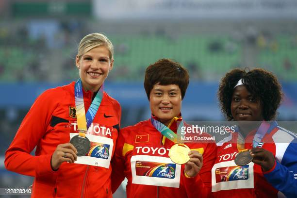 Silver medalist Nadine Mueller of Germany, gold medalist Yanfeng Li of China and bronze medalist Yarelys Barrios of Cuba celebrate on the podium with...