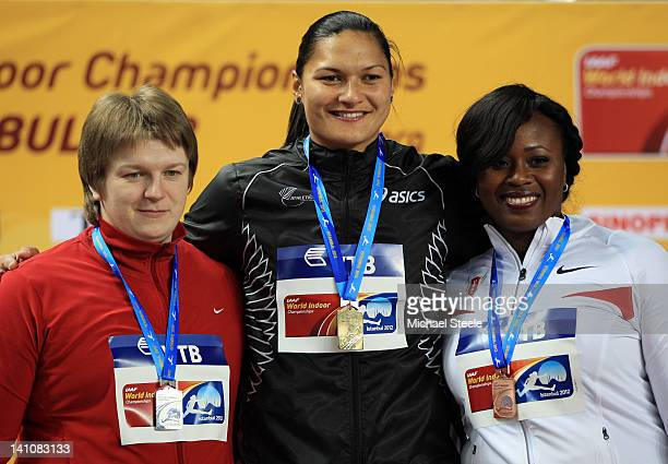 Silver medalist Nadzeya Ostapchuk of Belarus gold medalist Valerie Adams of New Zealandand and Michelle Carter of the United States stand on the...