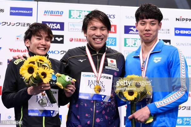 Silver medalist Naito Ehara of Japan , gold medalist Katsuhiro Matsumoto of Japan and bronze medalist Jaehoon Yang of South Korea pose during the...