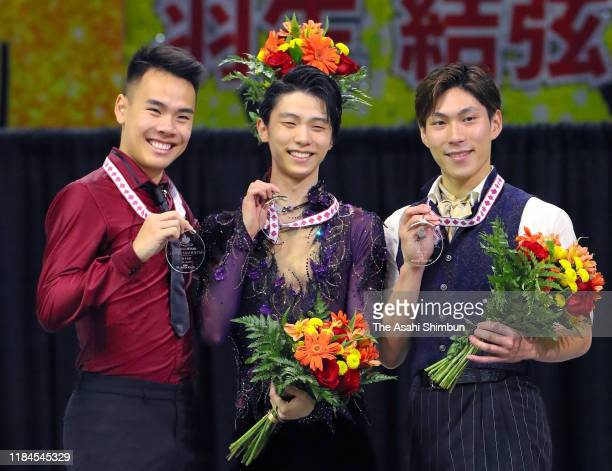 Silver medalist Nam Nguyen of Canada gold medalist Yuzuru Hanyu of Japan and bronze medalist Keiji Tanaka of Japan pose on the podium at the medal...