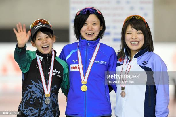 Silver medalist Nana Takagi gold medalist Miho Takagi and bronze medalist Ayano Sato celebrate on the podium at the medal ceremony for the Women's...