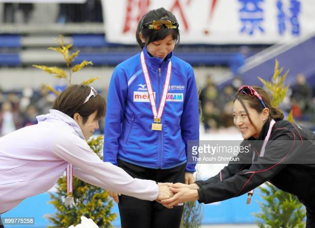 Silver medalist Nao Kodaira gold medalist Miho Takagi and bronze medalist Ayaka Kikuchi stand on the podium at the medal ceremony for the Ladies...