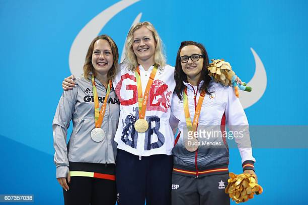 Silver medalist Naomi Mike Schnittger Gold medalist Hannah Russell of Great Britain and Bronze medalist Maria Delgado Nadal of Spain pose on the...