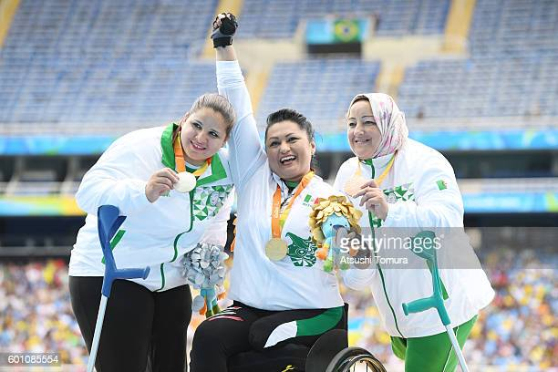 Silver medalist Nassima Saifi of Algeria gold medalist Angeles Ortiz Hernandez of Mexico and bronze medalist Nadia Medjmedj of Algeria celebrate on...