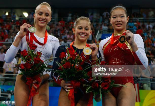 Silver medalist Nastia Liukin of the USA gold medalist Shawn Johnson of the USA and bronze medalist Cheng Fei of China pose on the podium during the...