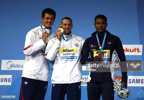 Silver medalist Nathan Adrian of the United States and gold medalist Caeleb Remel Dressel of the United States and bronze medalist Mehdy Metella of...