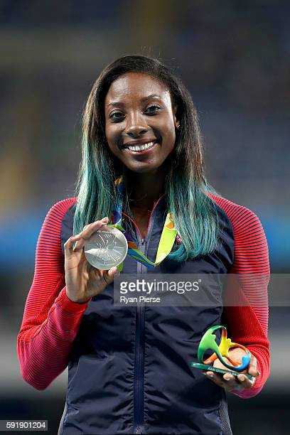Silver medalist Nia Ali of the United States poses on the podium during the medal ceremony for the Women's 100m Hurdles on Day 13 of the Rio 2016...