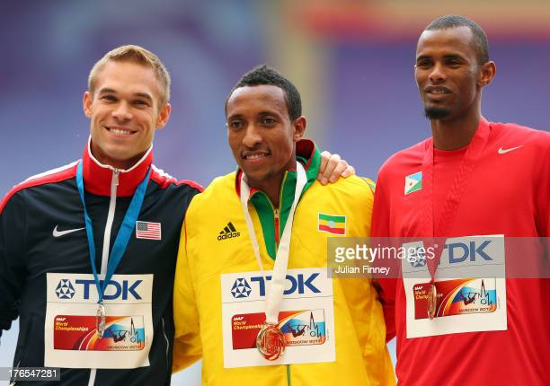 Silver medalist Nick Symmonds of the United States gold medalist Mohammed Aman of Ethiopia and bronze medalist Ayanleh Souleiman of Djibouti stand on...