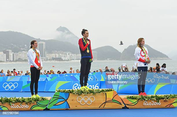 Silver medalist Nicola Spirig Hug of Switzerland, gold medalist Gwen Jorgensen of the United States and bronze medalist Vicky Holland of Great...