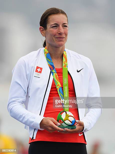 Silver medalist Nicola Spirig Hug of Switzerland stands on the podium during the medal ceremony for the Women's Triathlon on Day 15 of the Rio 2016...