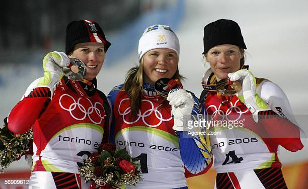 Silver medalist Nicole Hosp of Austria Gold medalist Anja Paerson of Sweden and bronze medalist Marlies Schild of Austria poses with their medals...