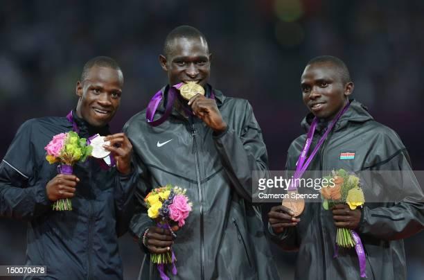 Silver medalist Nijel Amos of Botswana, gold medalist David Lekuta Rudisha of Kenya and bronze medalist Timothy Kitum of Kenya pose on the podium...