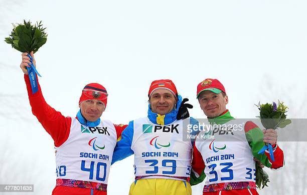 Silver medalist Nikolay Polukhin of Russia gold medalist Vitaliy Lukyanenko of Ukraine and bronze medalist Vasili Shaptsiaboi of Belarus celebrate in...