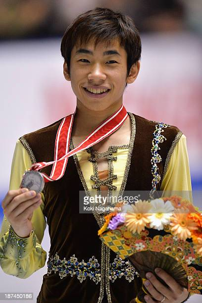 Silver medalist Nobunari Oda of Japan poses on the podium during day two of ISU Grand Prix of Figure Skating 2013/2014 NHK Trophy at Yoyogi National...