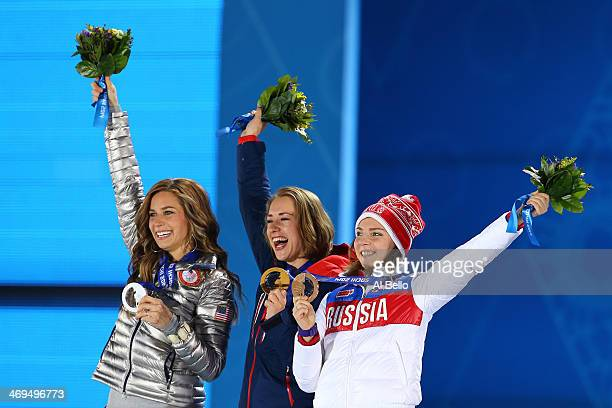 Silver medalist Noelle Pikus-Pace of the United States, gold medalist Lizzy Yarnold of Great Britain and bronze medalist Elena Nikitina of Russia on...