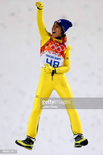 Silver medalist Noriaki Kasai of Japan celebrates on the podium during the flower ceremony after the Men's Large Hill Individual Final Round on day 8...