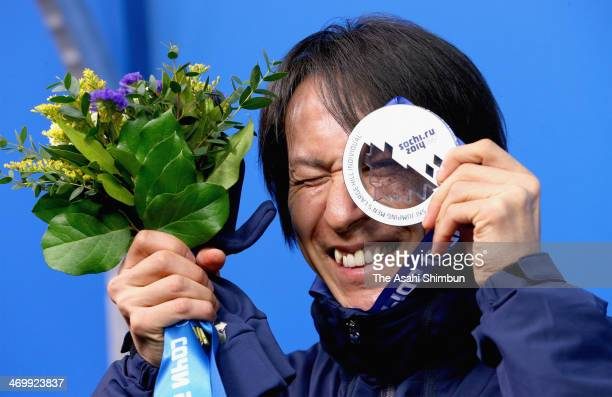 Silver medalist Noriaki Kasai of Japan celebrates on the podium during the medal ceremony for the Mens Large Hill Individual on day 9 of the Sochi...