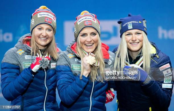 Silver medalist Norways Ingvild Flugstad Oestberg Gold medalist Norway's Therese Johaug and Bronze medalist Sweden's Frida Karlsson celebrate on the...