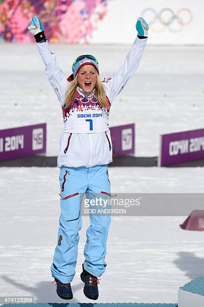 Silver medalist Norway's Therese Johaug celebrates at the podium in the Women's CrossCountry Skiing 30km Mass Start Free Flower Ceremony at the Laura...