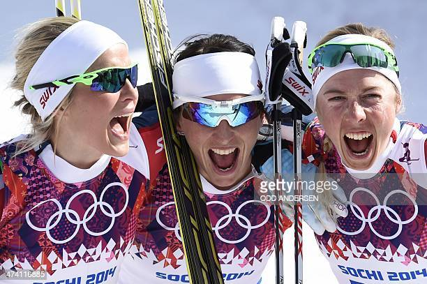 Silver medalist Norway's Therese Johaug gold medalist Norway's Marit Bjoergen and bronze medalist Norway's Kristin Stoermer Steira celebrate after...