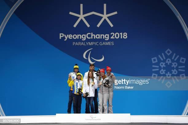 Silver medalist Oksana Shyshkova of Ukraine and her guide Vitaliy Kazakov gold medalist Mikhalina Lysova of Neutral Paralympic Athlete and her guide...