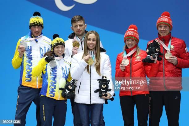 Silver medalist Oksana Shyshkova of Ukraine Gold medalist Mikhalina Lysova of Neutral Paralympic Athlete and bronze medalist Sviatlana Sakhanenka of...