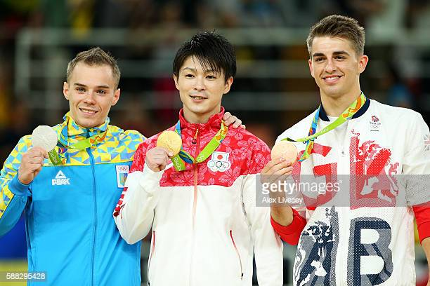 Silver medalist Oleg Verniaiev of UkraineGold medalist Kohei Uchimura of Japan and bronze medalist Max Whitlock of Great Britain pose for photographs...