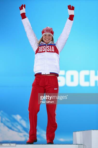 Silver medalist Olga Fatkulina of Russia celebrates during the medal for the Women's 500m on day five of the Sochi 2014 Winter Olympics at Medals...