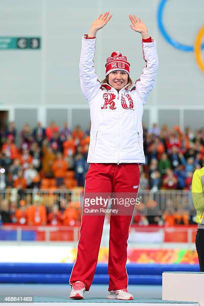 Silver medalist Olga Fatkulina of Russia celebrates on the podium during the flower ceremony for the Speed Skating Women's 500m Event during day 4 of...