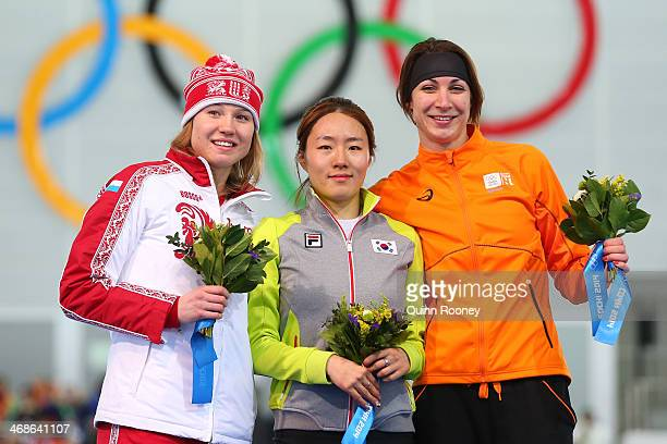 Silver medalist Olga Fatkulina of Russia gold medalist Sang Hwa Lee of South Korea and bronze medalist Margot Boer of the Netherlands on the podium...