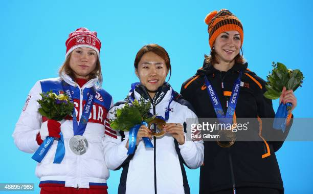 Silver medalist Olga Fatkulina of Russia gold medalist Sang Hwa Lee of South Korea and bronze medalist Margot Boer of the Netherlands celebrate on...