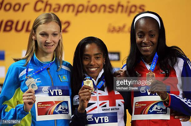 Silver medalist Olga Rypakova of Kazakhstan gold medalist Yamile Aldama of Great Britain and bronze medal Mabel Gay of Cuba stand on the podium...