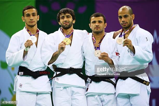 Silver medalist Orkhan Safarov of Azerbaijan, gold medalist Beslan Mudranov of Russia, bronze medalist Amiran Papinishvili of Georgia and bronze...