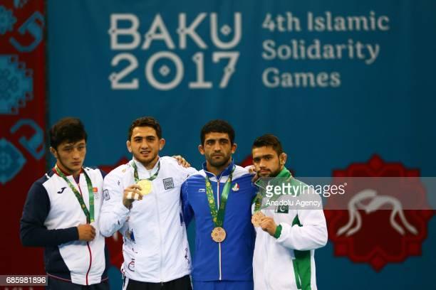 Silver medalist Osmanov Alibek of Kyrgyzstan gold medalist Haji Aliyev of Azerbaijan bronze medalists Esmaeilpoorjouybari Masoud of Iran and Wahab...