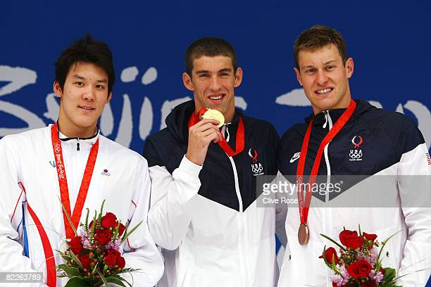 Silver medalist Park Taehwan of South Korea gold medalist Michael Phelps of the United States and bronze medalist Peter Vanderkaay of the United...