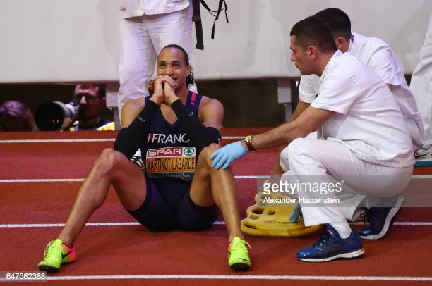 Silver medalist Pascal MartinotLagarde of France receives medical attention following the Men's 60 metres hurdles final on day one of the 2017...