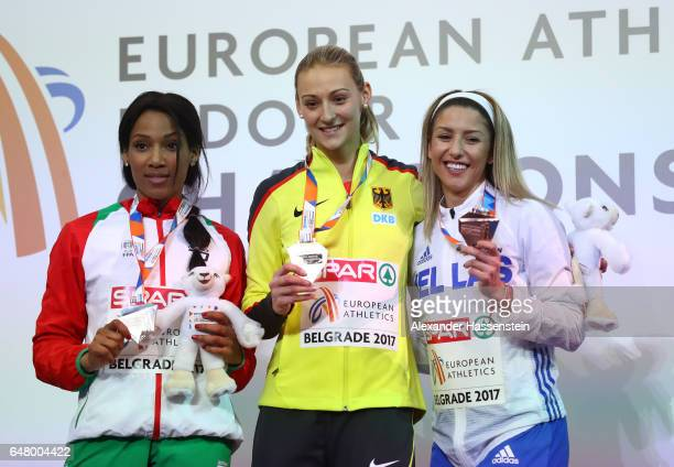 Silver medalist Patricia Mamona of Portugal gold medalist Kristin Gierisch of Germany and bronze medalist Paraskevi Papahristou of Greece pose during...
