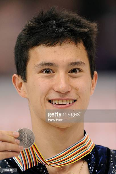 Silver medalist Patrick Chan of Canada poses with his medal after the Men's Free Skate during the 2009 ISU World Figure Skating Championships on...