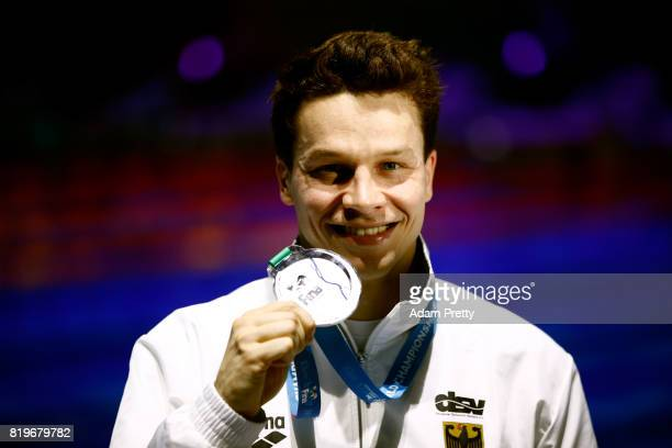 Silver medalist Patrick Hausding of Germany poses with the medal won during the Men's 3M Springboard final on day seven of the Budapest 2017 FINA...