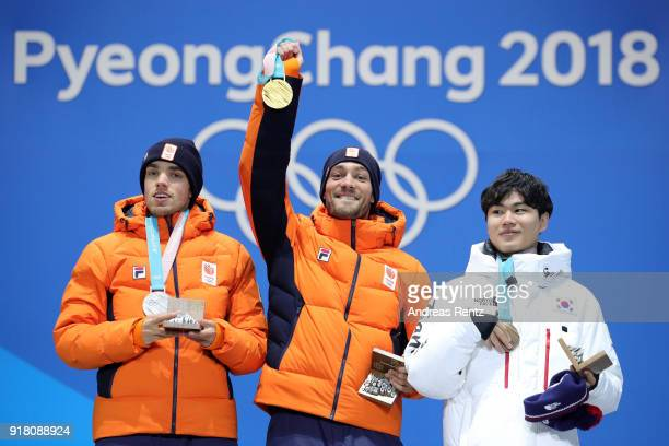 Silver medalist Patrick Roest of the Netherlands, gold medalist Kjeld Nuis of the Netherlands and bronze medalist Min Seok Kim of Korea pose during...