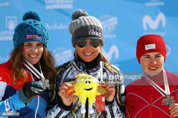 Silver medalist Patrizia Kummer of Switzerland gold medalist Ester Ledecka of the Czech Republic and bronze medalist Ekaterina Tudegesheva of Russia...
