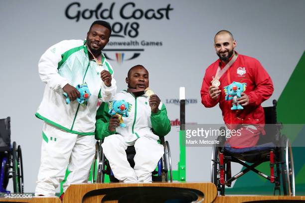 COAST AUSTRALIA APRIL Silver medalist Paul Kehinde of Nigeria gold medalist Roland Ezuruike of Nigeria and bronze medalist Ali Jawad of England pose...