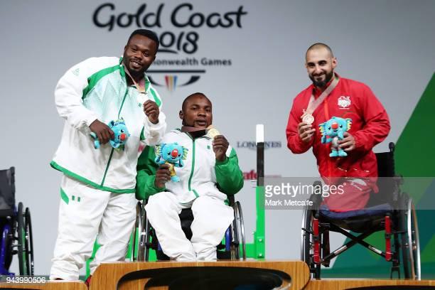 COAST AUSTRALIA APRIL Silver medalist Paul Kehinde of Nigeria gold medalist Roland Ezuruike of Nigeria and bronze medalist Ali Jawad of England pose...