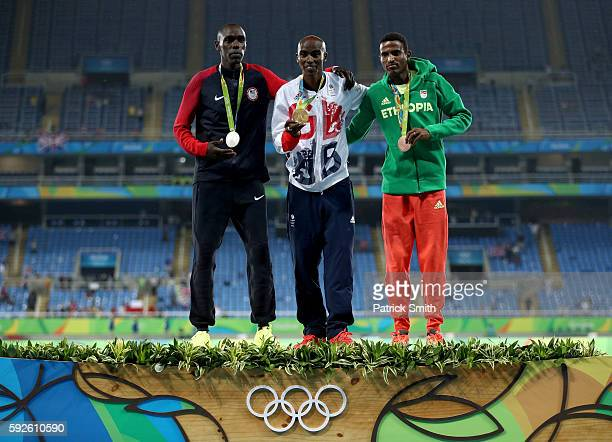 Silver medalist Paul Kipkemoi Chelimo of the United States, gold medalist Mohamed Farah of Great Britain and bronze medalist Hagos Gebrhiwet of...