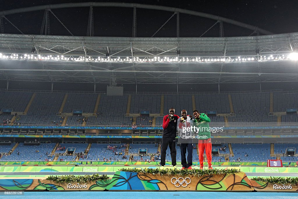 Silver medalist Paul Kipkemoi Chelimo of the United States, gold medalist Mohamed Farah of Great Britain and bronze medalist Hagos Gebrhiwet of Ethiopia stand on the podium during the medal ceremony for the Men's 5000 meter on Day 15 of the Rio 2016 Olympic Games at the Olympic Stadium on August 20, 2016 in Rio de Janeiro, Brazil.